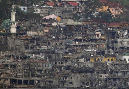Damaged buildings and houses are seen as government troops continue their assault during clearing operations against pro-IS militants group which have seized control over large parts of Marawi City, Philippines September 11, 2017. REUTERS/Romeo Ranoco