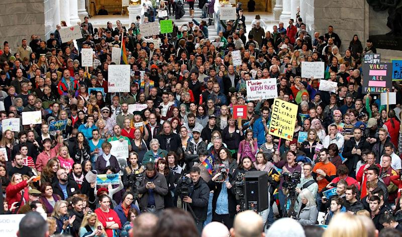 Supporters of gay marriage fill the rotunda as they gathered to rally at the Utah State Capitol Friday Jan. 10, 2014, and to deliver a petition with over 58,000 signatures in support of gay marriage to Utah Governor Gary Herbert. (AP Photo/Steve C. Wilson)