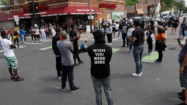 PHOTO: Protesters gather by a makeshift memorial, Wednesday, May 27, 2020, in Minneapolis, near the site where George Floyd, a black man who was taken into police custody on Monday and later died. (Jim Mone/AP)