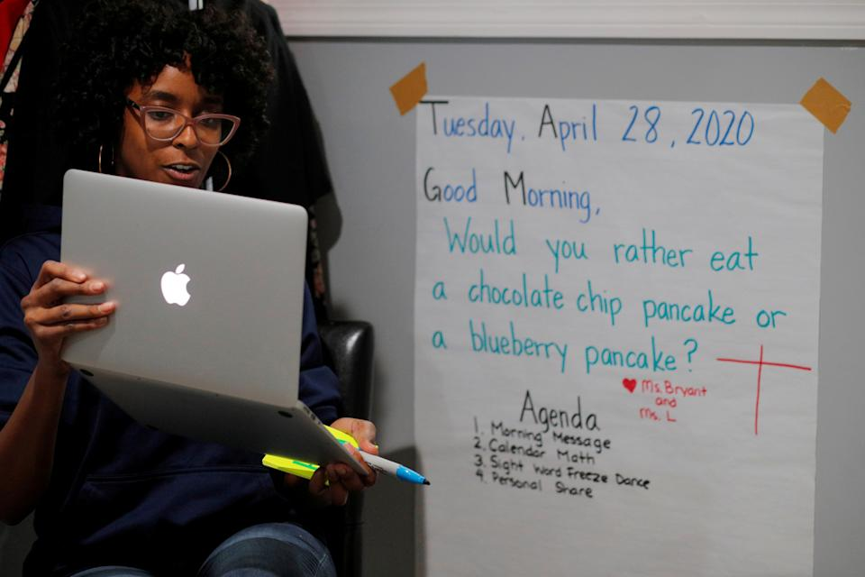 Boston Public School teacher Princess Bryant teaches her kindergarten class via video-conference from her apartment after schools were closed for the remainder of the school year because of the coronavirus disease (COVID-19) outbreak in Boston, Massachusetts, U.S., April 28, 2020. REUTERS/Brian Snyder     TPX IMAGES OF THE DAY