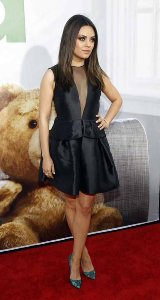 """Cast member Mila Kunis poses at the premiere of """"Ted"""" at the Grauman's Chinese theatre in Hollywood, California June 21, 2012. The movie opens in the U.S. on June 29.  REUTERS/Mario Anzuoni  (UNITED STATES - Tags: ENTERTAINMENT)"""