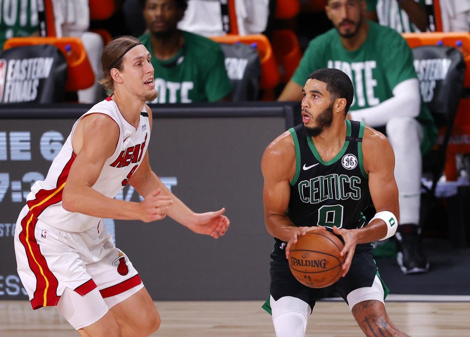 LAKE BUENA VISTA, FLORIDA - SEPTEMBER 25: Jayson Tatum #0 of the Boston Celtics drives the ball against Kelly Olynyk #9 of the Miami Heat during the second quarter in Game Five of the Eastern Conference Finals during the 2020 NBA Playoffs at AdventHealth Arena at the ESPN Wide World Of Sports Complex on September 25, 2020 in Lake Buena Vista, Florida. NOTE TO USER: User expressly acknowledges and agrees that, by downloading and or using this photograph, User is consenting to the terms and conditions of the Getty Images License Agreement.  (Photo by Mike Ehrmann/Getty Images)