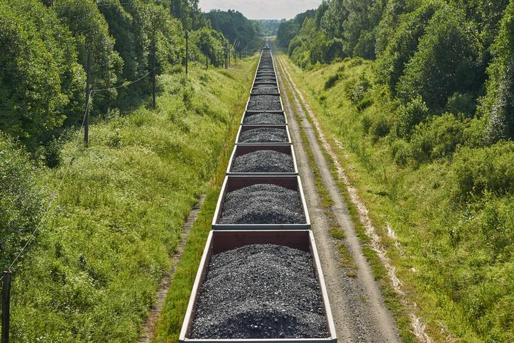A train hauling cars full of coal.