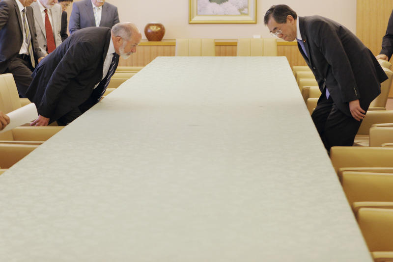 International Atomic Energy Agency's nuclear safety review mission team leader Michael Weightman of Britain, left, and Japanese Foreign Minister Takeaki Matsumoto take their seats for a meeting at Foreign Ministry in Tokyo, Wednesday, May 25, 2011. The major international mission to investigate Japan's flooded, radiation-leaking Fukushima Dai-ichi nuclear complex opened Tuesday as new information emerged on just how serious the crisis was in the early days after the March 11 tsunami. (AP Photo/Itsuo Inouye)