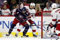 Columbus Blue Jackets' Alexander Wennberg (10), of Sweden, battles with Carolina Hurricanes' Nino Niederreiter (21), of the Czech Republic, for the puck during the first period of an NHL hockey game, in Raleigh, N.C., Saturday, Oct. 12, 2019. (AP Photo/Karl B DeBlaker)