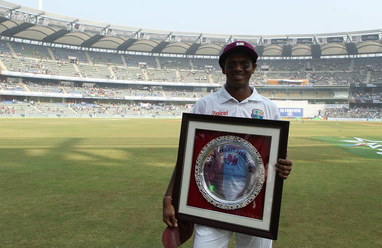 Shivnarine Chanderpaul of West Indies poses with his momentos to celebrate his 150th test cap during day one of the second Star Sports test match between India and The West Indies held at The Wankhede Stadium in Mumbai, India on the 14th November 2013  This test match is the 200th test match for Sachin Tendulkar and his last for India.  After a career spanning more than 24yrs Sachin is retiring from cricket and this test match is his last appearance on the field of play.   Photo by: Ron Gaunt - BCCI - SPORTZPICS  Use of this image is subject to the terms and conditions as outlined by the BCCI. These terms can be found by following this link:  https://ec.yimg.com/ec?url=http%3a%2f%2fsportzpics.photoshelter.com%2fgallery%2fBCCI-Image-Terms%2fG0000ahUVIIEBQ84%2fC0000whs75.ajndY&t=1495763524&sig=tLbJMnpUe82AV9E933bnOw--~C