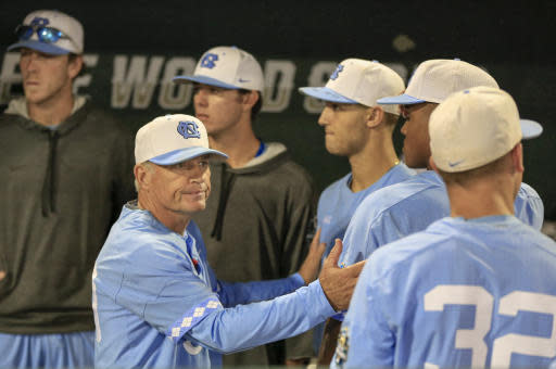 North Carolina coach Mike Fox consoles players following the team's 11-6 loss to Oregon State in an NCAA College World Series baseball elimination game in Omaha, Neb., Wednesday, June 20, 2018. (AP Photo/Nati Harnik)
