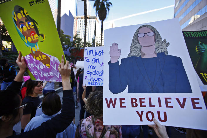 Demonstrators hold signs as they gather at Pershing Square during the Women's March in Los Angeles on Saturday, Jan. 19, 2019. (Photo: Damian Dovarganes/AP)