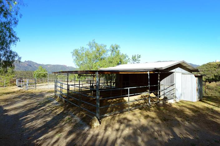 <p>The property includes 10 barn stalls, stables, an outdoor arena, a round pen, eight enclosed pastures and other animal-centric features.<br></p><p><i>(Photo: Total Agent)</i><br></p>