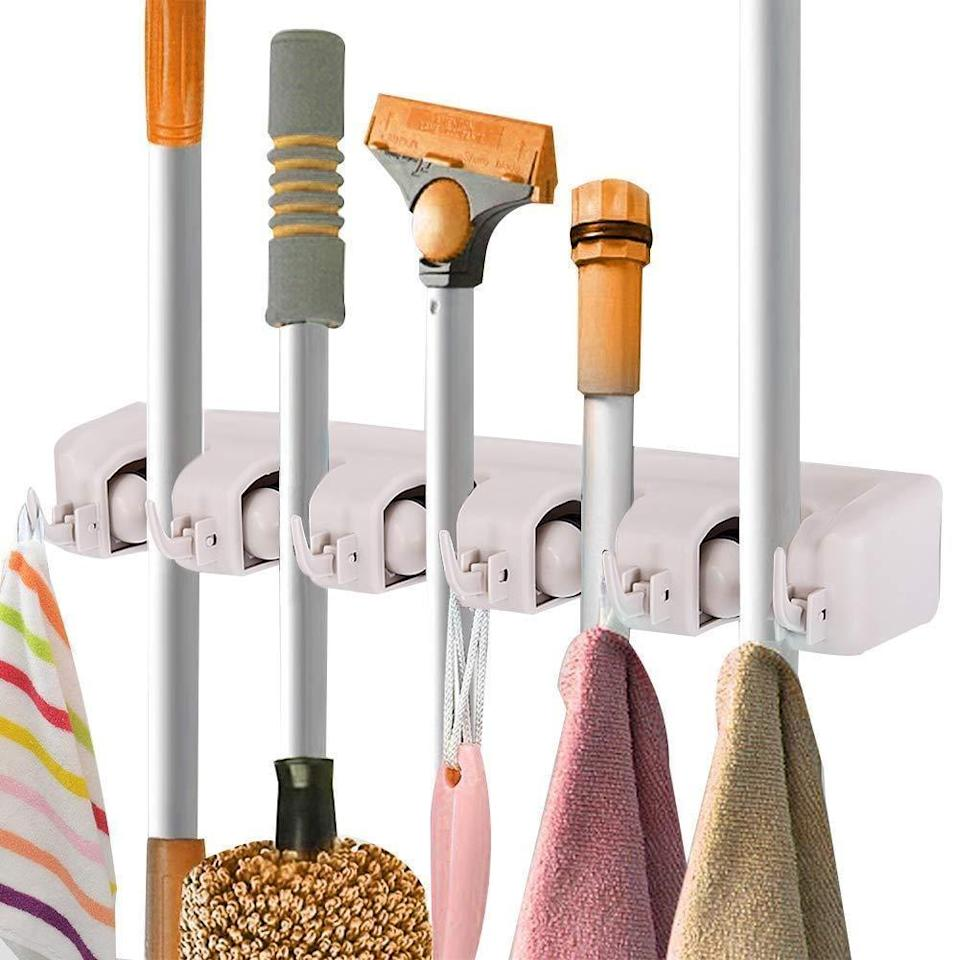 <p>Keep your cleaning products neat and in order with this <span>Costway Mop Holder Hanger</span> ($18, originally $33).</p>