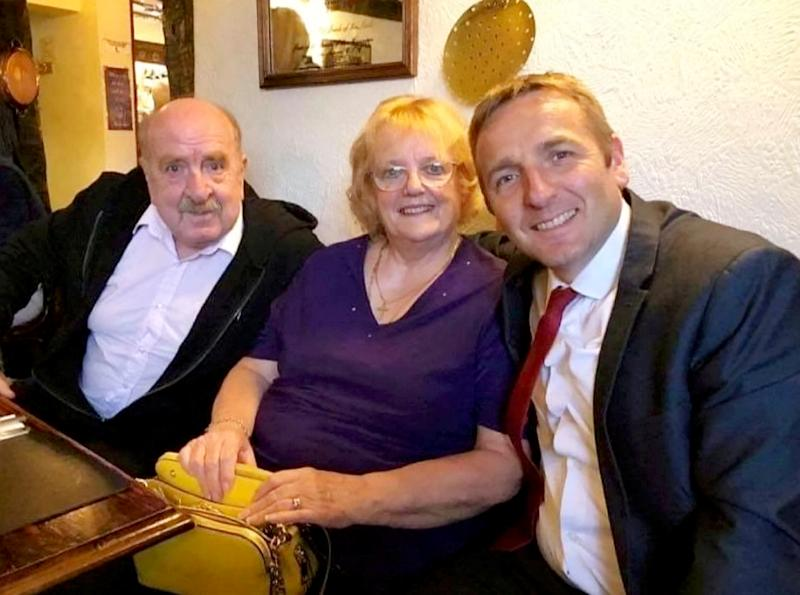 Barbara Barnes with husband John (left) and son, Nick (right). Barnes, 74, had the wrong implant fitted in October 2018. (SWNS)