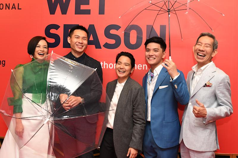 SINGAPORE, Nov. 21, 2019 -- Director Anthony Chen 2nd L of the film Wet Season poses for a group photo with producer Tan Si En C, actress Yeo Yann Yann 1st L, actors Yang Shi Bin 1st R and Koh Jia Ler during the opening ceremony of the 30th Singapore International Film Festival (SGIFF) at the Capitol Theatre in Singapore, Nov. 21, 2019. The 30th SGIFF kicked off here Thursday night at the Capitol Theatre with the Singapore premiere of the film Wet Season, marking a bountiful line-up of events ahead. (Photo by Then Chih Wey/Xinhua via Getty) (Xinhua/xinjiapo via Getty Images)