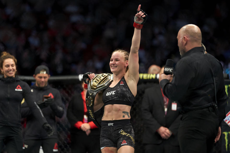 HOUSTON, TEXAS - FEBRUARY 08:  Valentina Shevchenko of Kyrgyzstan celebrates her TKO victory over Katlyn Chookagian in their women's flyweight championship bout during the UFC 247 event at Toyota Center on February 08, 2020 in Houston, Texas. (Photo by Cooper Neill/Zuffa LLC via Getty Images)
