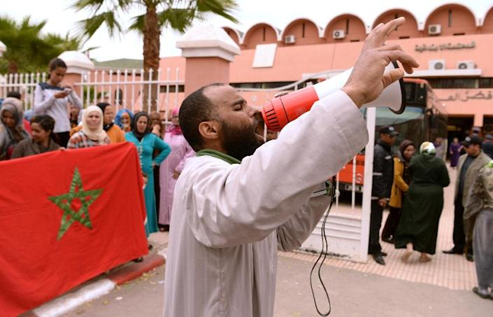 Moroccan protesters living in the neighbourhood where two men presumed to be homosexual were assaulted last month, demonstrate against homosexuality and in support of family members who are on trial in connection with the assault, on April 11, 2016 (AFP Photo/Fadel Senna)