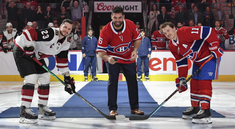 Laurent Duvernay-Tardif of the Kansas City Chiefs gets set to drop the ceremonial puck along with Montreal's Brendan Gallagher and Arizona's Oliver Ekman-Larsson. (Photo by Francois Lacasse/NHLI via Getty Images)