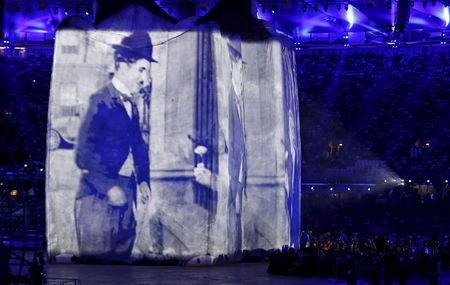 Image of actor Charlie Chaplin is projected onto a structure during the opening ceremony of the London 2012 Olympic Games at the Olympic Stadium, Britain in this July 27, 2012 file photo. REUTERS/Mike Blake/Files