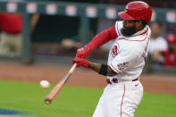Cincinnati Reds' Brian Goodwin hits an RBI sacrifice fly during the first inning of the team's baseball game against the Pittsburgh Pirates in Cincinnati, Tuesday, Sept. 15, 2020. (AP Photo/Bryan Woolston)
