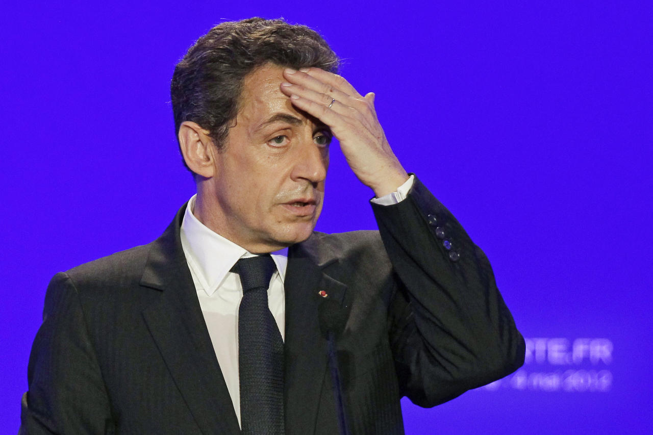 FILE This Friday, May 4, 2012 file photo shows France's then President and conservative candidate for re-election in 2012, Nicolas Sarkozy as he delivers a speech during a campaign meeting in Sables d'Ollonne, western France. French investigators searched former President Nicolas Sarkozy's home and office on Tuesday July 3, 2012 as part of a probe into suspected illegal financing of his 2007 presidential campaign by the L'Oreal cosmetics heiress, an official said. (AP Photo/Michel Euler, File)