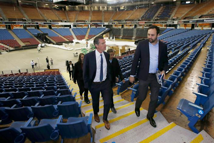 California Gov. Gavin Newsom tours Sleep Train Arena in Sacramento. The governor recently announced a $125 million fund to help undocumented Californians, many of whom are Latino, make it through the economic crisis spurred by the coronavirus pandemic.