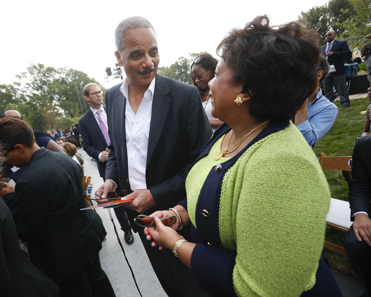 <p>Former Attorney General Eric Holder, left, talks with current Attorney General Loretta Lynch as they arrive for the dedication ceremony of the Smithsonian Museum of African American History and Culture on the National Mall in Washington, Saturday, Sept. 24, 2016. (AP Photo/Pablo Martinez Monsivais) </p>