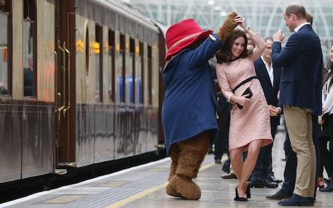 The Duchess of Cambridge dances with Paddington bear at an event in October last year - Credit: Jonathan Brady/Getty