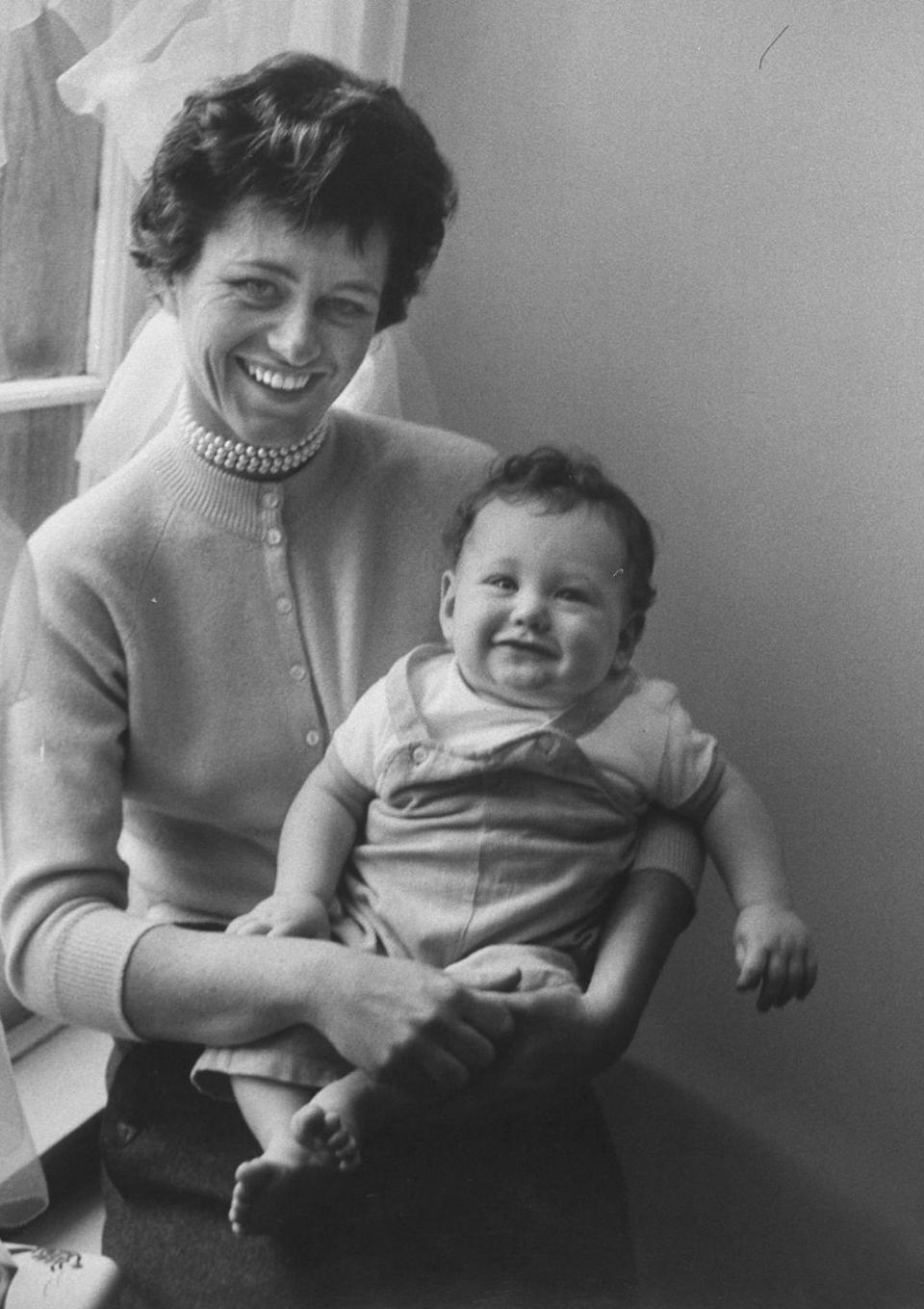 <p>Jean posed with her baby son, Stephen. She would go on to have another son, William, as well as adopting two daughters, Amanda and Kym. </p>