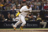 San Diego Padres' Victor Caratini runs to first base after hitting an RBI-single against the Atlanta Braves in the sixth inning of a baseball game Saturday, Sept. 25, 2021, in San Diego. (AP Photo/Derrick Tuskan)