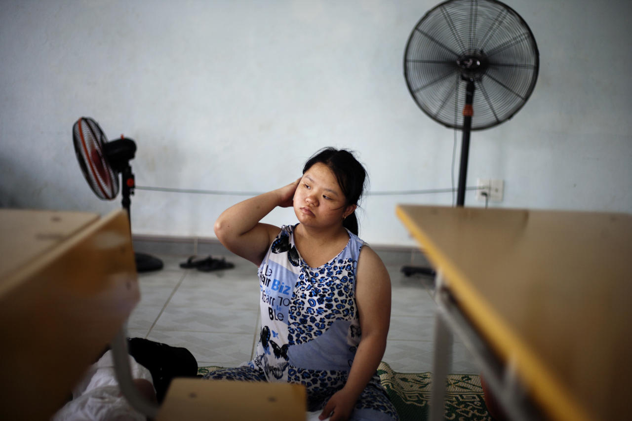 In this photo taken Tuesday Aug. 7, 2012, Le Thi Kim Lien wakes up after noon's nap at a rehabilitation center in Danang, Vietnam. The children were born with physical and mental disabilities that the center's director said were caused by their parents' exposure to the chemical dioxin in the defoliant Agent Orange. Washington was slow to respond, but on Thursday, Aug. 9, 2012 the U.S. for the first time will begin cleaning up leftover dioxin that was stored at the former military base, now part of Danang's airport. (AP Photo/Maika Elan)