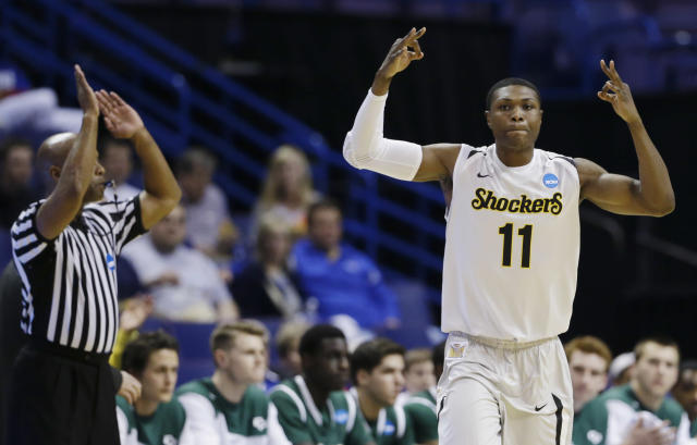 Wichita State forward Cleanthony Early (11) celebrates his three-point basket against Cal Poly during the first half of a second-round game in the NCAA college basketball tournament Friday, March 21, 2014, in St. Louis. (AP Photo/Jeff Roberson)