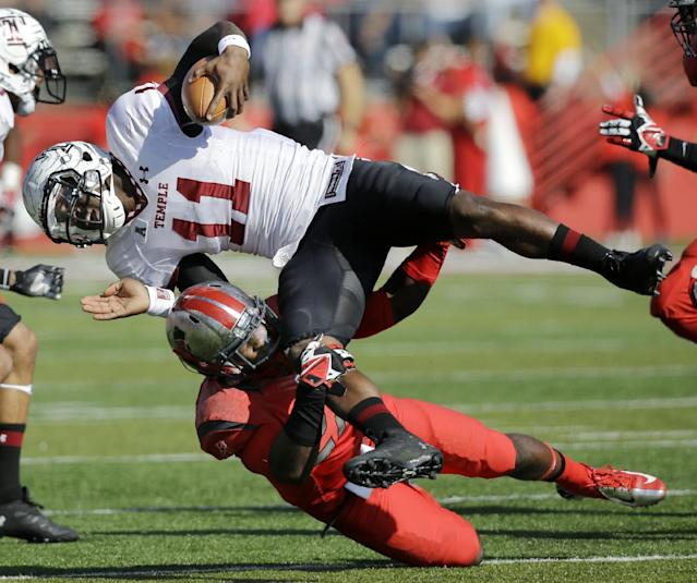 Rutgers defensive back Delon Stephenson (27) tackles Temple quarterback P.J. Walker (11) during the first half of an NCAA college football game in Piscataway, N.J., Saturday, Nov. 2, 2013. (AP Photo/Mel Evans)
