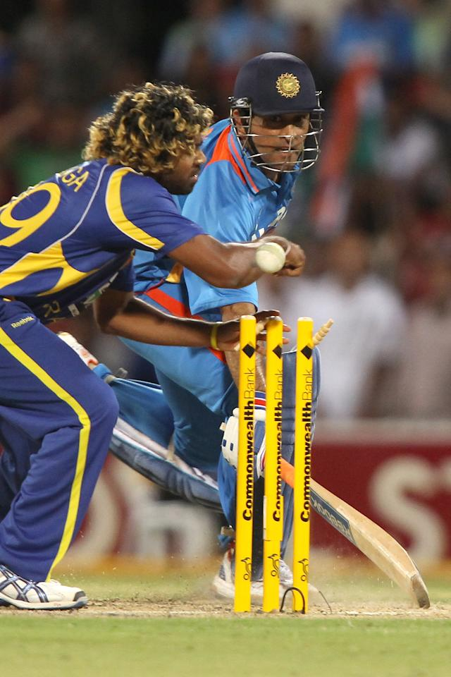 ADELAIDE, AUSTRALIA - FEBRUARY 14: MS Dhoni (R) of India makes his ground as Lasith Malinga (L) of Sri Lanka fumbles the ball during the One Day International match between India and Sri Lanka at Adelaide Oval on February 14, 2012 in Adelaide, Australia.  (Photo by Morne de Klerk/Getty Images)