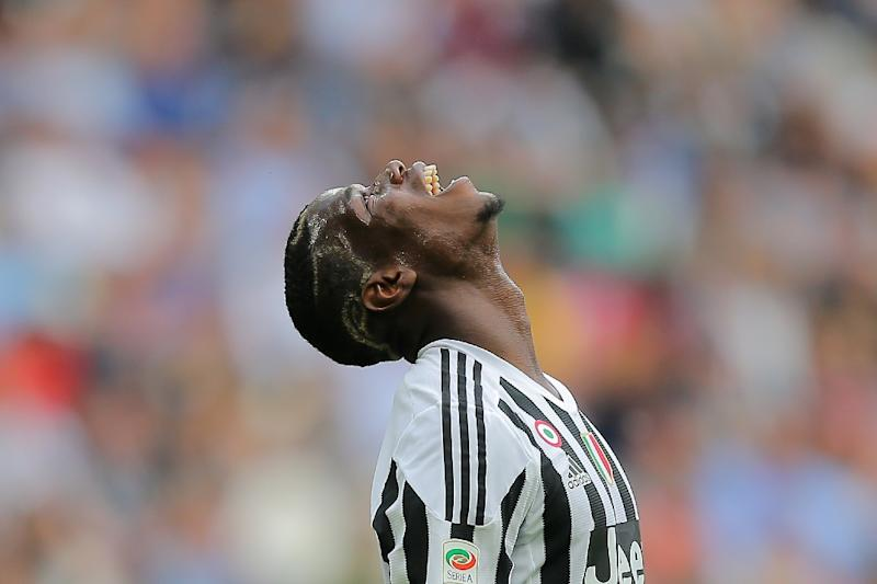 """'We love him, but he is a Manchester United player,"""" said Fabio Paratici of former Juventus star Paul Pogba (AFP Photo/MARCO BERTORELLO)"""