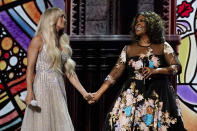 Carrie Underwood, left, and CeCe Winans perform at the 56th annual Academy of Country Music Awards on Saturday, April 17, 2021, at the Grand Ole Opry in Nashville, Tenn. The awards show airs on April 18 with both live and prerecorded segments. (AP Photo/Mark Humphrey)