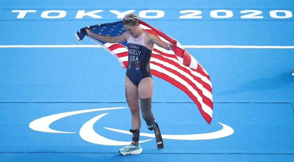 Tokyo, Japan - Team USA's Allysa Seely celebrates after winning the gold medal in the women's PTS2 triathlon at the 2020 Tokyo Paralympics. (Photo by CHARLY TRIBALLEAU/AFP via Getty Images)