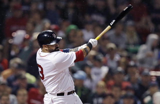Boston Red Sox's Sandy Leon follows through on an RBI single during the seventh inning of a baseball game against the Los Angeles Angels at Fenway Park in Boston, Wednesday, June 27, 2018. (AP Photo/Charles Krupa)