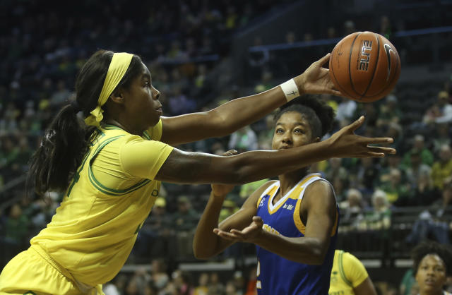 Oregon's Ruthy Hebard, left, and UC Riverside's Marina Ewodo battle for a rebound during the second quarter of an NCAA college basketball game in Eugene, Ore., Monday, Dec. 16, 2019. (AP Photo/Chris Pietsch)