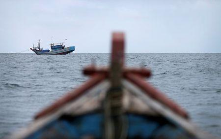 FILE PHOTO - Traditional fishing boats work off the east coast of Natuna Besar, Indonesia July 9, 2014. REUTERS/Tim Wimborne/File Photo