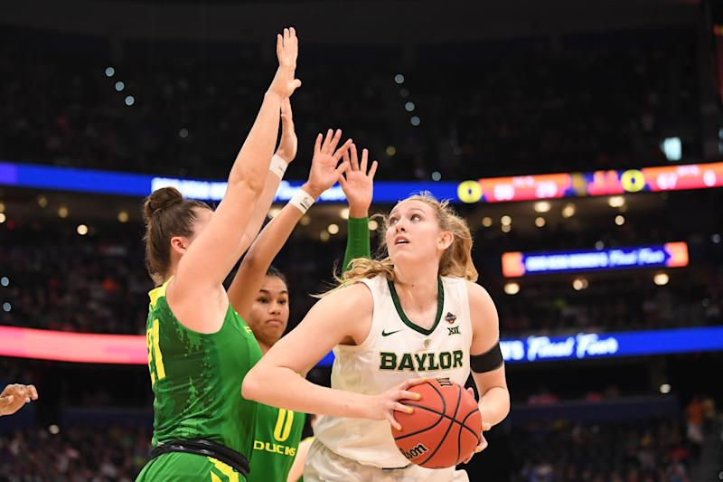 TAMPA, FL - APRIL 05: Lauren Cox #15 of the Baylor Bears looks for an open shot against Erin Boley #21 and Satou Sabally #0 of the Oregon Ducks at Amalie Arena on April 5, 2019 in Tampa, Florida. (Photo by Ben Solomon/NCAA Photos via Getty Images)