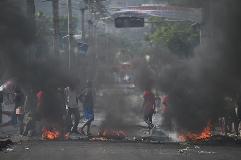 Protesters barricade a street in the Port-au Prince suburb of Petion-Ville to protest an increase in fuel prices which the government then suspended