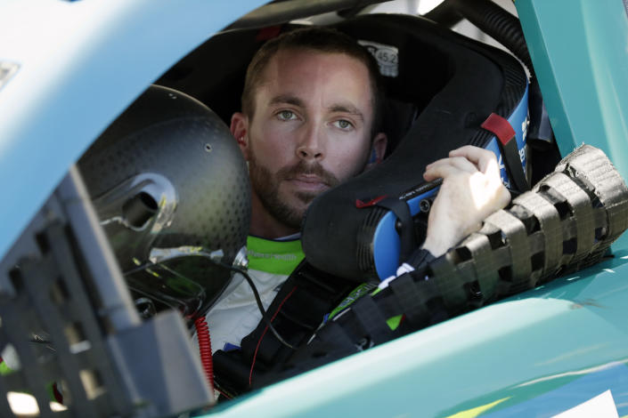 FILE - In this Feb. 9, 2020, file photo, Ross Chastain prepares to exit his car during NASCAR auto race qualifying at Daytona International Speedway in Daytona Beach, Fla. Former NASCAR champion Matt Kenseth will once again come out of retirement to compete for Chip Ganassi Racing as the replacement for fired driver Kyle Larson. Chastain was assumed the leading contender to replace Larson but the team instead announced Monday, April 27, 2020, it will go with two-time Daytona 500 winner Kenseth for the remainder of the season. (AP Photo/John Raoux, File)