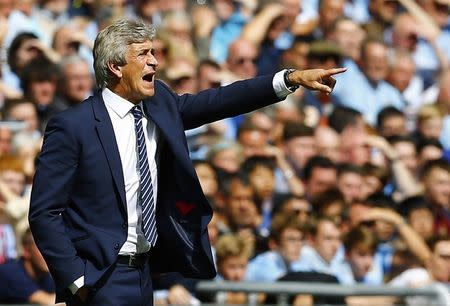 Manchester City manager Pellegrini reacts during their English Community Shield soccer match against Arsenal at Wembley Stadium in London