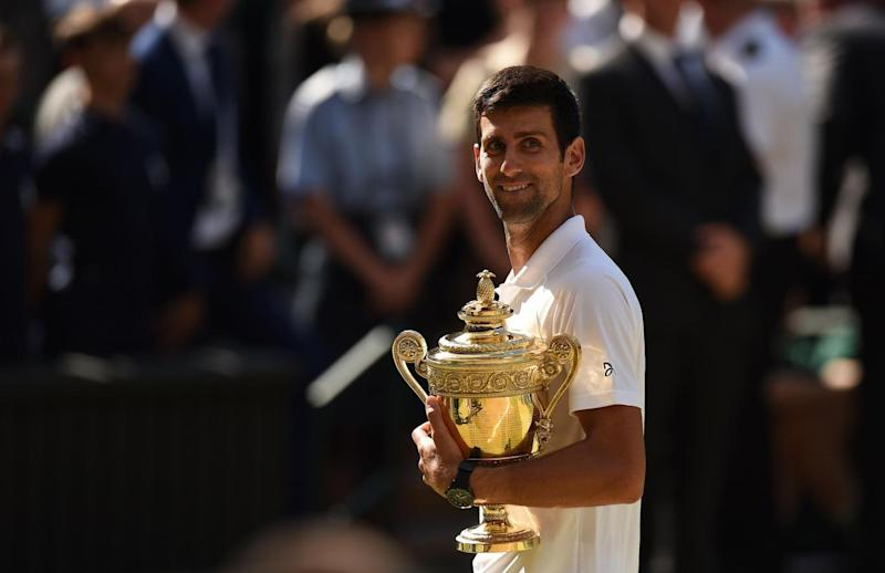 True champion: Djokovic celebrates a fourth Wimbledon crown (AFP/Getty Images)