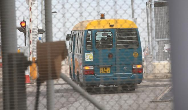 Once inside the airport compound, Kwai was transferred to another van. Photo: Dickson Lee