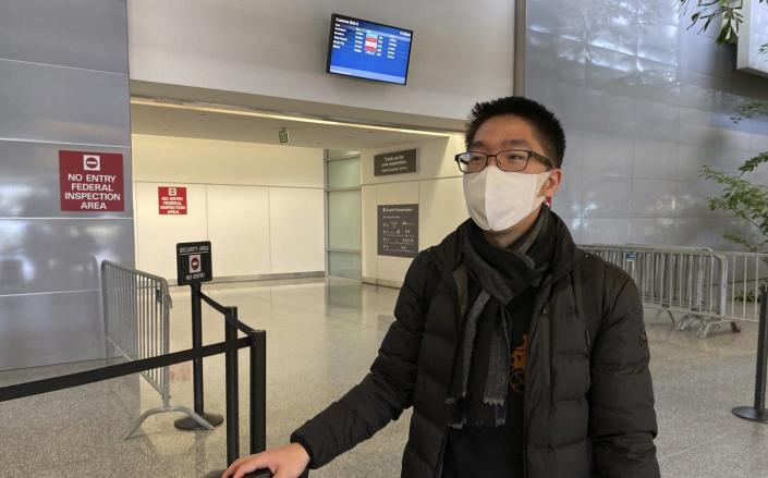 "<span class=""caption"">Bill Chen at San Francisco International Airport after arriving on a flight from Shanghai. Chen said his temperature was screened at the Shanghai airport before he departed. </span> <span class=""attribution""><a class=""link rapid-noclick-resp"" href=""http://www.apimages.com/metadata/Index/China-Outbreak-Flying/1a46c5b4a0aa41158a3ea2483c55b913/2/0"" rel=""nofollow noopener"" target=""_blank"" data-ylk=""slk:AP Photo / Terry Chea"">AP Photo / Terry Chea</a></span>"
