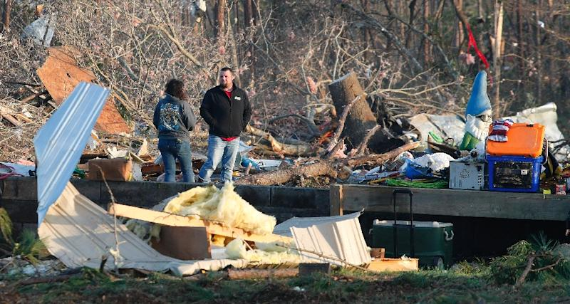 Residents and friends help clean up after a tornado struck in Beauregard, Alabama (AFP Photo/Tami Chappell)