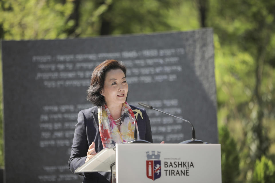 U.S Ambassador to Albania Yuri Kim speaks during the inauguration of a memorial in Tirana, Thursday, July 9, 2020. A memorial to the six million Jews murdered during the World War II and for the Albanians who protected them from the Nazis was inaugurated Thursday in the capital. (Xhulio Hajdari/Tirana City Hall via AP)