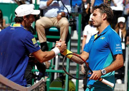 Tennis - Monte Carlo Masters - Monaco, 20/04/2017. Stan Wawrinka of Switzerland (R) shakes hand with Pablo Cuevas of Uruguay after their match. REUTERS/Eric Gaillard