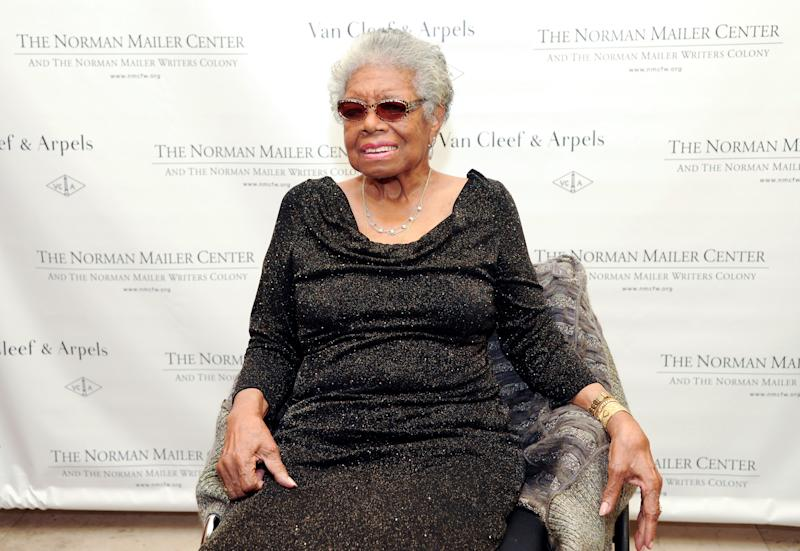 Lifetime Achievement Award recipient Maya Angelou poses for photographs during the fifth annual Norman Mailer Center benefit gala at the New York Public Library on Thursday, Oct. 17, 2013, in New York. (Photo by Evan Agostini/Invision/AP)