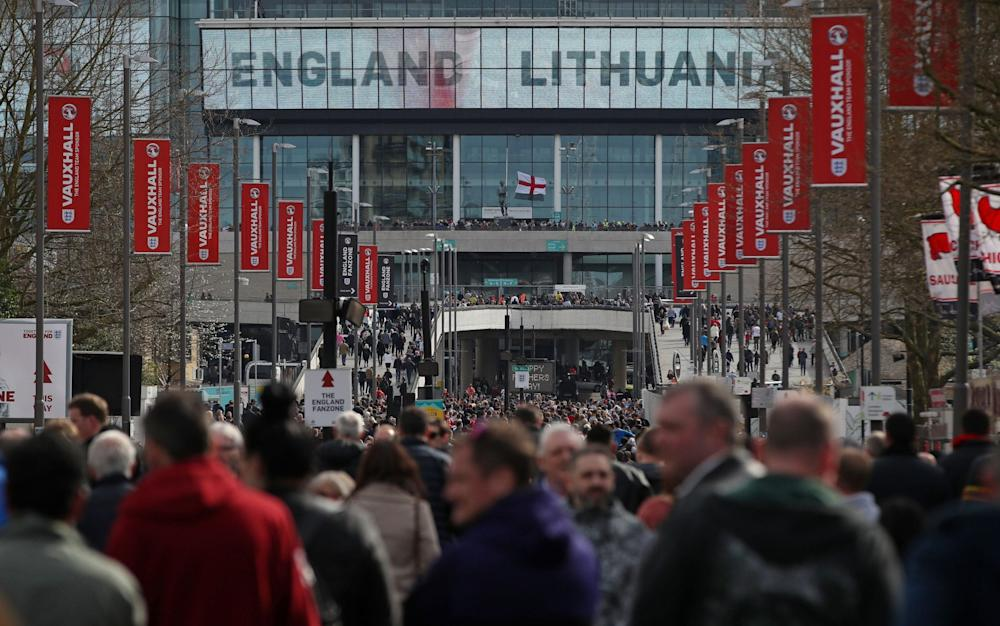 England fans make their way to Wembley - Credit: PA