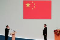 Macau Chief Executive Ho Iat-seng takes an oath in front of Chinese President Xi Jinping at a ceremony on the 20th anniversary of the former Portuguese colony's return to China in Macau